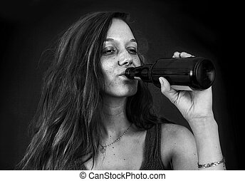 Drunk woman drinking beer over black BW