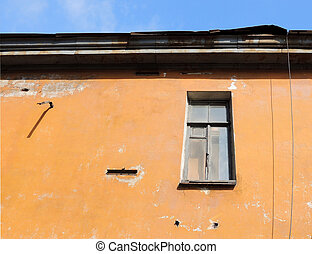 The old painted wall with a lone window