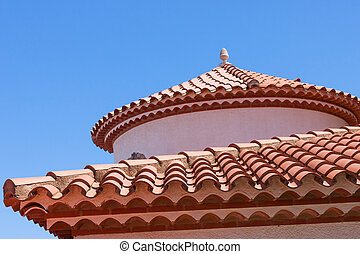Small statue on the red tiled roof - Small statue of an egg...