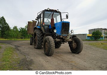 Tractor - Dirty tractor with the trailer
