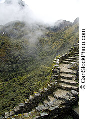 Machu Picchu, Peru - Ancient path to the city of Machu...