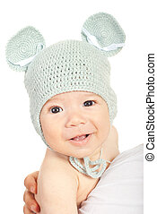 Smiling baby boy in knitted mouse cap isolated on white...