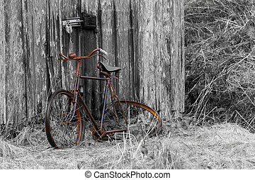 Old Bicycle - a rusty old bike leaning against a barn door