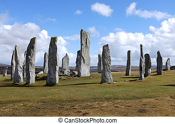 Callanish standing stones. - Standing stone circle on green...