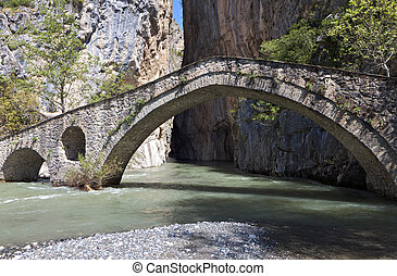 Portitsa gorge in Greece - Portitsa gorge and the old stone...