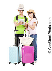 happy couple tourist with tablet pc