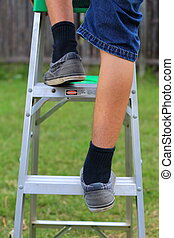 Climbing a Ladder - A close up view of someone climbing up a...