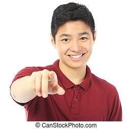 Teenager Pointing at You - A smiling teenager pointing at...