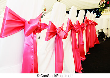 Wedding chair covers - Chairs at wedding reception with red...