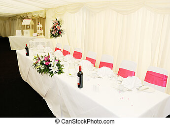 Wedding reception table showing decoration of flowers and...