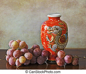 Antique oriental red vase and grapes