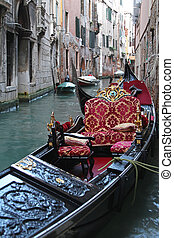 Gondola in canal - Traditional luxurious gondola in narrow...