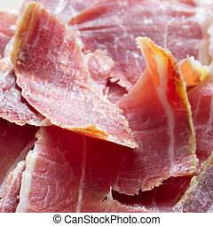 serrano ham tapas - closeup of spanish serrano ham tapas