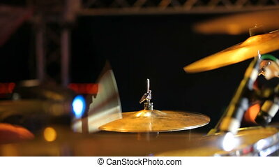 Rock band performing in a nightclub. Close-up of drummer