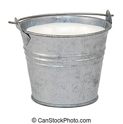 Milk in a miniature metal bucket, isolated on a white...