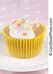cupcake with icing and round sprinkles
