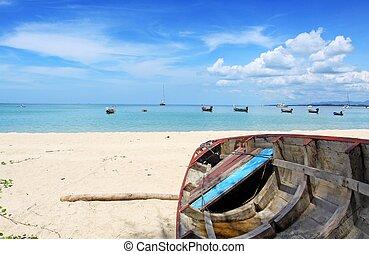 boat on the beach at Nai yang beach, Phuket Thailand
