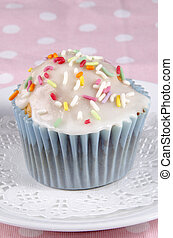cupcake with icing and colorful sprinkles