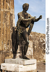 bronze statue inside the pompeii ruins, italy