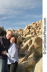 Senior couple standing in desert