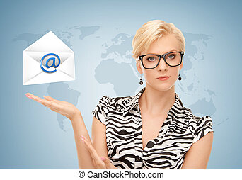 woman showing virtual envelope - woman with world map...
