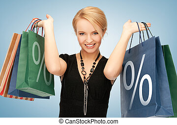 woman with shopping bags - picture of attractive woman with...