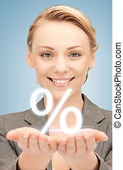 woman showing sign of percent in her hands - picture of...