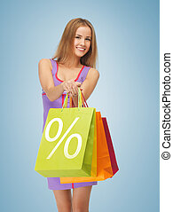 woman carrying shopping bags - picture of attractive woman...
