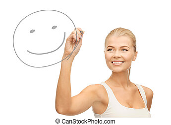 woman drawing happy face - smiling woman in white shirt...