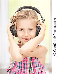 happy girl in big headphones - picture of happy girl in big...