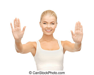 woman showing palms - bright picture of young woman showing...