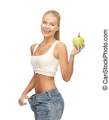 sporty woman showing big pants - picture of sporty woman...