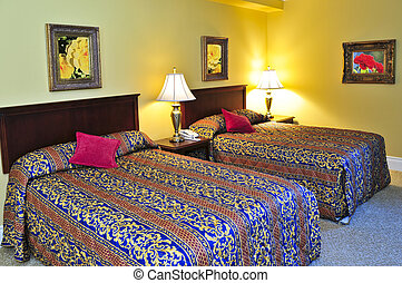 Bedroom interior with two double beds, images on the wall...
