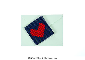 Green envelop with red knitted heart isolated on white background