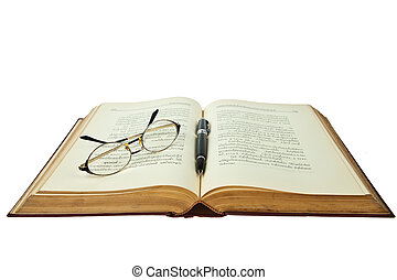opened book with eye glasses and pen isolated on white...