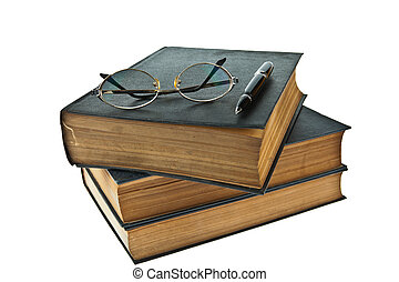 Stack of old books with eye glasses and pen isolated on white background