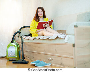 woman reposes from household chores - Young woman reposes...