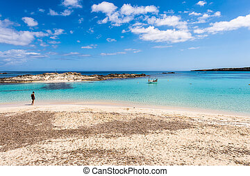 Tourist visiting Els Pujols beach in Formentera island,...