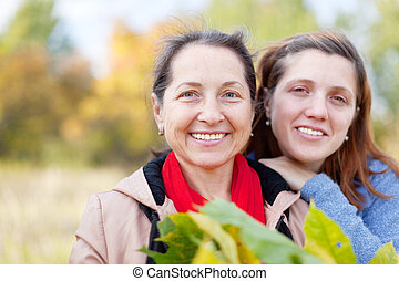 happy women in autumn  garden