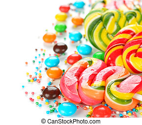 Multi colored candy - Multi colored candy on a white...