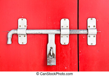 Close up Iron lock on the red door