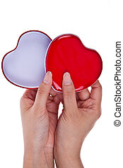 Red and white hearts in two hands