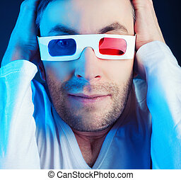 man & glasses - young man, looking through stereo glasses