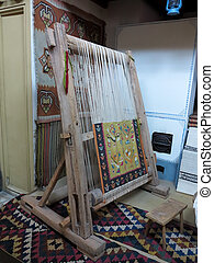 Ancient wooden vintage loom producing carpet - Ancient...
