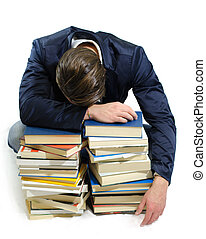 Young man falling asleep on books - Young student sleeping...