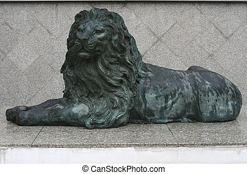 Green Lion Sculpture lean on the mable floor