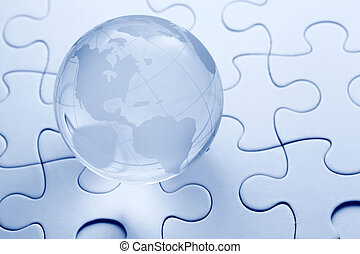 Glass globe ball with puzzle background