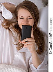 woman sending a text with mobile phone - Beautiful woman...