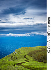 Summer landscape in mountains and the dark blue sky with...