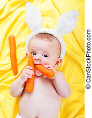 boy with a carrot in his hand - cute little boy with a...